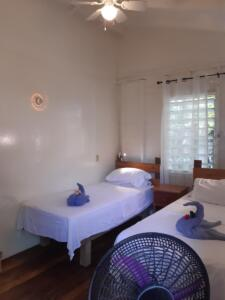 room 1 -- sleeps 2 - two single beds, shared solar hot water bath