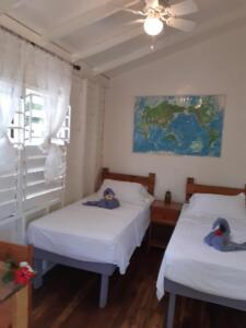 room 4 -- sleeps 2 - two single beds, shared solar hot water bath