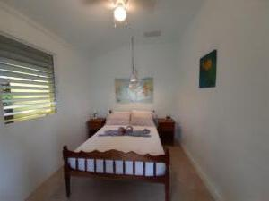 room 5 -- sleeps 2 - one double bed, shared solar hot water bath