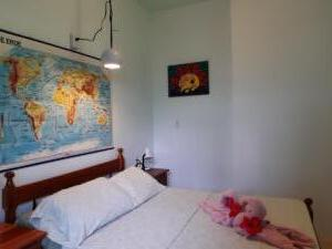 room 6 -- sleeps 2 - one double bed, shared solar hot water bath