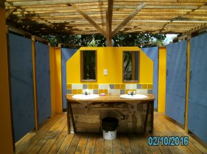 communal bathrooms  -- 4 toilets, 4 solar hot water showers