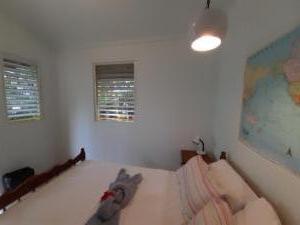 room 5 -- sleeps 2 - one double bed, shared solar hot water bath