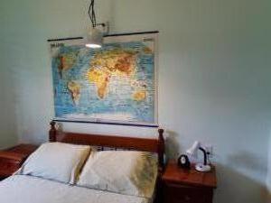 room 6 -- sleeps 2 - one double bed, shared solar hot water bath